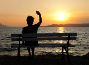 Woman on bench and sunset - vacation background